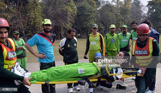 PakistanIndiacricketblindFOCUS by Khurram SHAHZAD This photograph taken on February 14 2014 shows Pakistan's blind cricket captain Zeeshan Abbasi and...