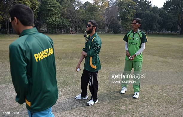 PakistanIndiacricketblindFOCUS by Khurram SHAHZAD This photograph taken on February 14 2014 shows visually impaired Pakistan cricketers as they take...