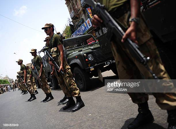 Pakistanis army soldiers stand guard outside an electoral materials distribution centre in Karachi on May 10 2013 Pakistan goes to the polls on May...