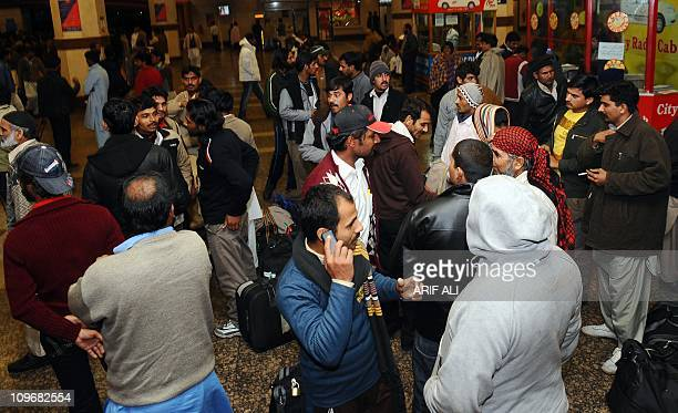 Pakistanis arrive at Allama Iqbal International Airport in Lahore on March 1 2011 after fleeing from Libya The UN refugee agency said a humanitarian...