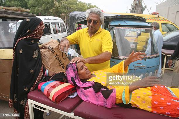 Pakistanis carry a patient who was affected by the heatwave to take her to a hospital in Karachi Pakistan on June 25 2015 More than 1000 people have...