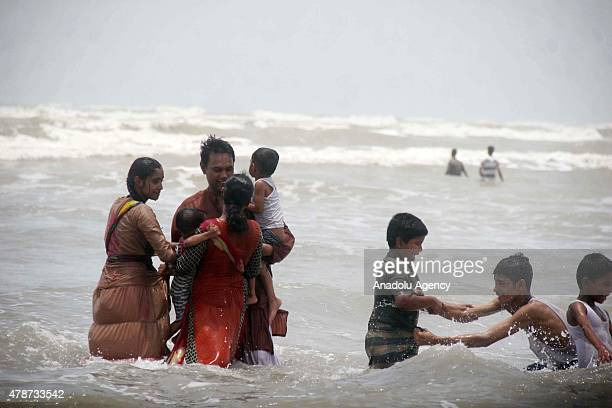 Pakistanis cool off at a beach on the Arabian Sea during a heatwave in Karachi Pakistan on June 27 2015 After a week of extreme conditions the...