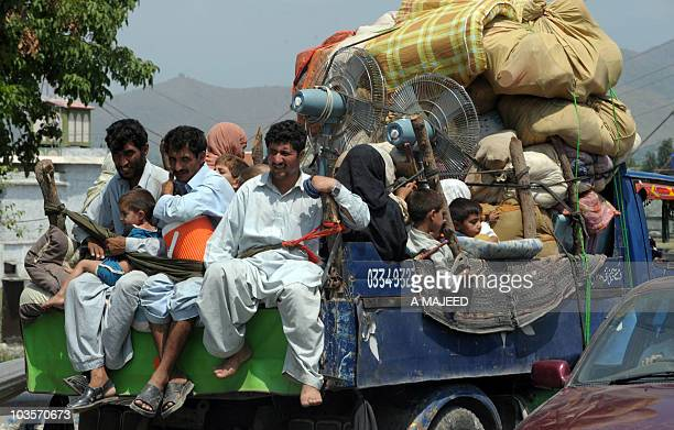 Pakistanis displaced by military operations against Taliban militants return to Mingora the main town of Swat valley on August 1 2009 Schools...
