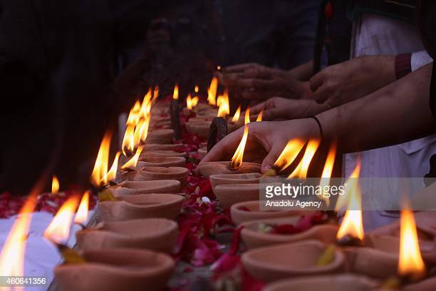 Pakistanis hold candle light vigil in Karachi Pakistan on December 18 in memory of the victims of the Taliban assault on an armyrun school in the...