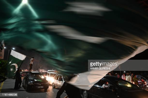 TOPSHOT Pakistanis take to the streets during Independence Day celebrations in Islamabad on August 14 as the nation marks the 73rd anniversary of...