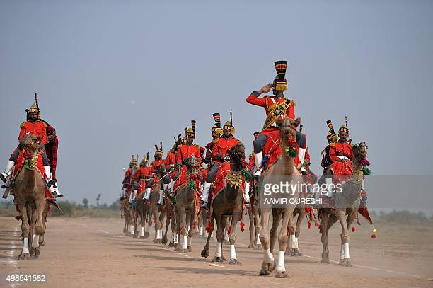 Pakistan-Military-Camels, FEATURE by Nasir JAFFRY In this photograph taken on November 13 Band Major of Pakistan Desert Rangers, Muhammad Iqbal...
