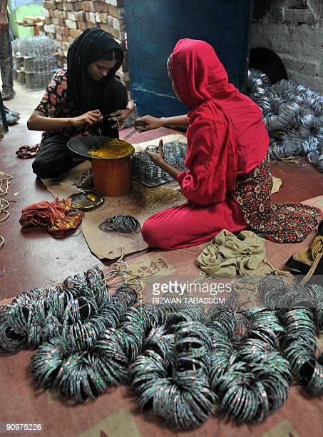 PakistanreligioneconomyEid BY HASAN MANSOOR This picture taken on September 2 2009 shows Pakistani girls shining bangles at a house in Hyderabad...