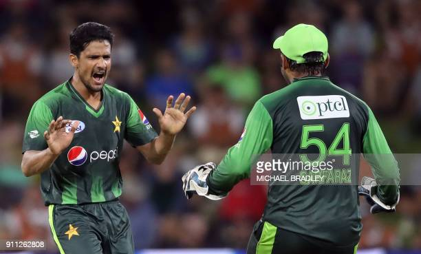Pakistan's Aamer Yamin and Sarfraz Ahmed celebrate the wicket of New Zealand's Colin de Grandhomme during the third Twenty20 international cricket...