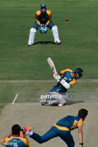 Pakistan's Abid Ali avoids a bouncer during a practice session at the National Stadiumin Karachi on January 22 ahead of their first cricket test...