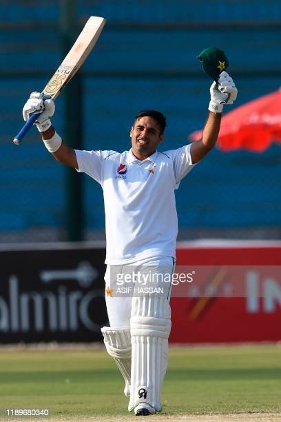 Pakistan's Abid Ali celebrates after scoring 150 runs during the third day of the second Test cricket match between Pakistan and Sri Lanka at the...