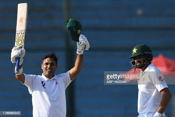 Pakistan's Abid Ali celebrates after scoring 150 runs next to captain Azhar Ali during the third day of the second Test cricket match between...