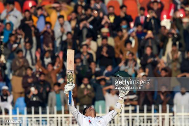 Pakistan's Abid Ali celebrates after scoring a century during the fifth and final day of the first Test cricket match between Pakistan and Sri Lanka...