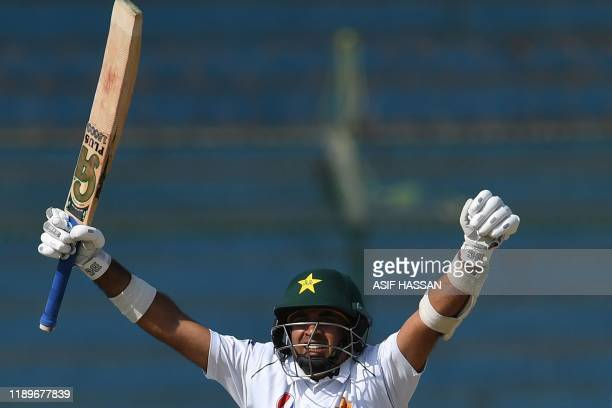 Pakistan's Abid Ali celebrates after scoring a century during the third day of the second Test cricket match between Pakistan and Sri Lanka at the...
