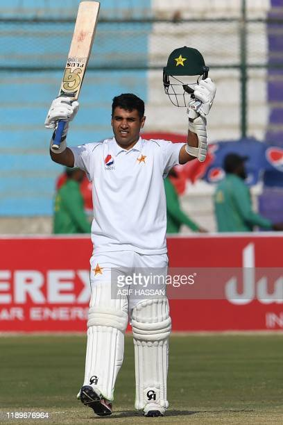 Pakistan's Abid Ali celebrates after scoring a half century during the third day of the second Test cricket match between Pakistan and Sri Lanka at...