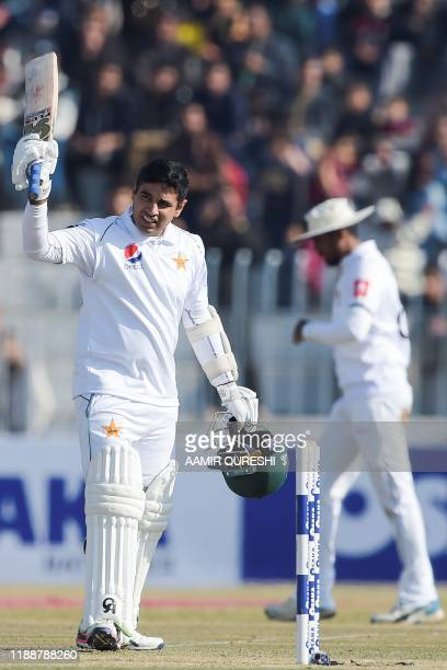 Pakistan's Abid Ali celebrates after scoring half century during the fifth and final day of the first Test cricket match between Pakistan and Sri...