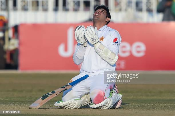 Pakistan's Abid Ali offers a prayer after scoring century during the fifth and final day of the first Test cricket match between Pakistan and Sri...