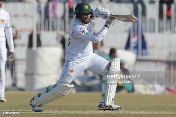 Pakistan's Abid Ali plays a shot during the fifth and final day of the first Test cricket match between Pakistan and Sri Lanka at the Rawalpindi...