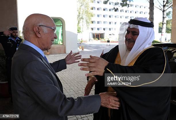 Pakistan's Adviser for National Security and Foreign Affairs Sartaj Aziz greets Bahraini Foreign Minister Sheikh Khaled bin Ahmed alKhalifa upon his...