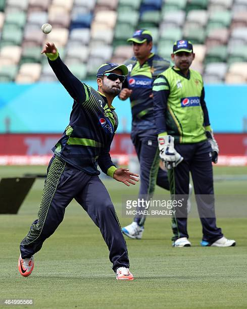 Pakistan's Ahmad Shahzad throws during a training session ahead of their 2015 Cricket World Cup Group B match against United Arab Emirates in Napier...