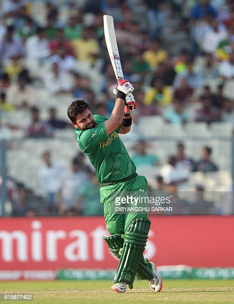 Pakistan's Ahmed Shehzad plays a shot during the World T20 cricket tournament match between Bangladesh and Pakistan at the Eden Gardens in Kolkata on...