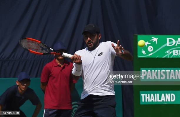 Pakistan's AisamUlHaq Qureshi hits a return during the Davis Cup AsiaOceania GroupII tennis match against Thailand's Kittiphong Wachiramanowong at...