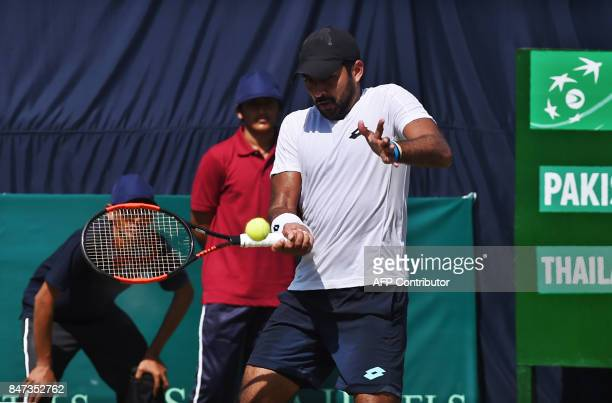 Pakistan's AisamUlHaq Qureshi hits a return during the Davis Cup AsiaOceania GroupII tennis match against Thailand's Kittiphong Wachiramanowong at...