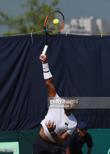 Pakistan's AisamUlHaq Qureshi serves during the Davis Cup AsiaOceania GroupII tennis singles match against Thailand's Kittiphong Wachiramanowong at...
