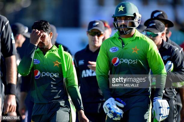 Pakistan's Amir Yamin and teammate Rumman Raees walk from the field after their loss during the 5th oneday international cricket match between New...