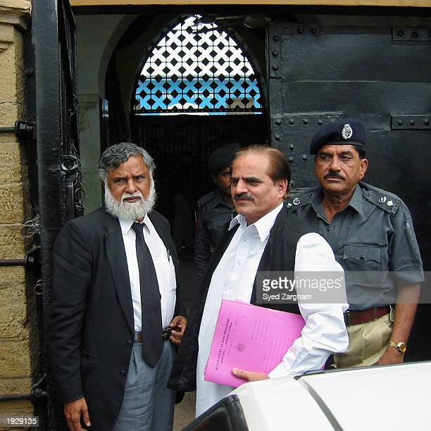 Pakistan's antiterrorism court judge Syed Alay Maqbool Rizvi arrives at the central jail in Karachi to announce his verdict in last year's deadly...