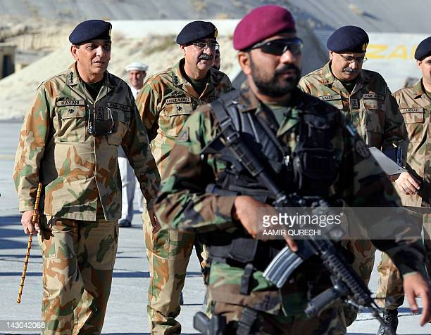 Pakistan's Army Chief General Ashfaq Kayani arrives for a press conference at Skardu airport in northern Pakistan on April 18 after visiting the...