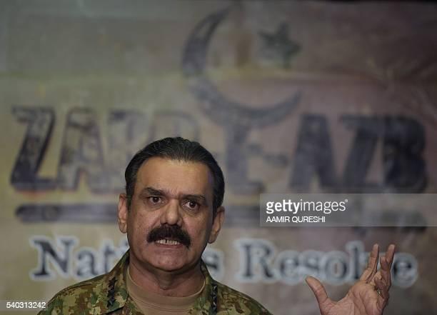 Pakistan's army spokesman Asim Saleem Bajwa addresses media representatives about the details of military operation ZarbeAzb in Rawalpindi on June 15...