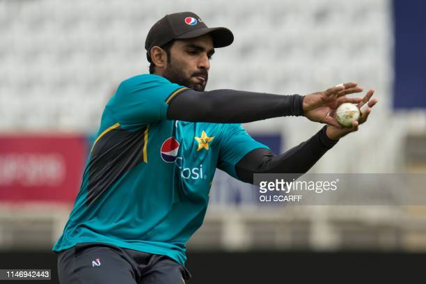 Pakistan's Asif Ali takes a catch during a training session at Trent Bridge Cricket Ground in Nottingham central England on May 30 on the eve of...