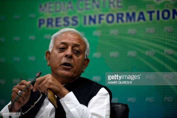 Pakistan's Aviation Minister Ghulam Sarwar Khan speaks during a press conference in Islamabad on June 24 after announcing in parliament the findings...