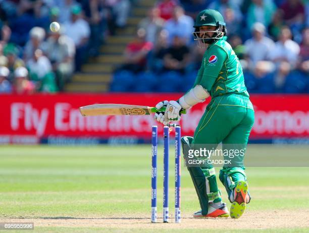 Pakistan's Azhar Ali looks as the bails fly and hi loses his wicket for 76 runs during the ICC Champions Trophy semifinal cricket match between...