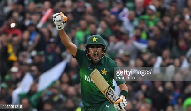 TOPSHOT Pakistan's Babar Azam celebrates after scoring a century during the 2019 Cricket World Cup group stage match between New Zealand and Pakistan...