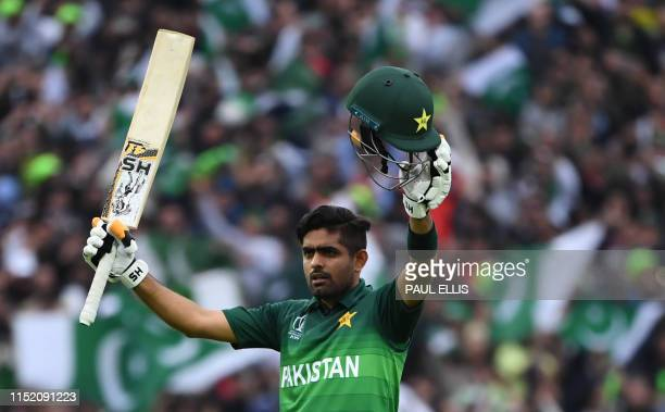 Pakistan's Babar Azam celebrates after scoring a century during the 2019 Cricket World Cup group stage match between New Zealand and Pakistan at...