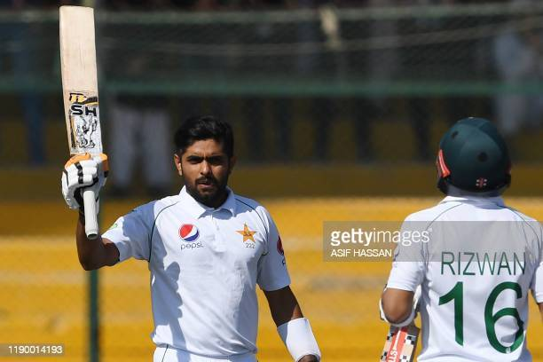 Pakistan's Babar Azam celebrates after scoring a century during the fourth day of the second Test cricket match between Pakistan and Sri Lanka at the...