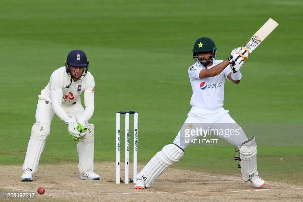 Pakistan's Babar Azam plays a shot as England's Jos Buttler keeps wicket on the fifth day of the third Test cricket match between England and...