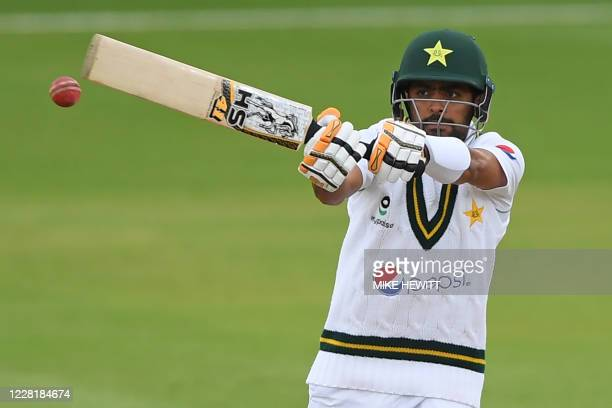 Pakistan's Babar Azam swings the bat at a delivery from England's Jofra Archer on the fourth day of the third Test cricket match between England and...