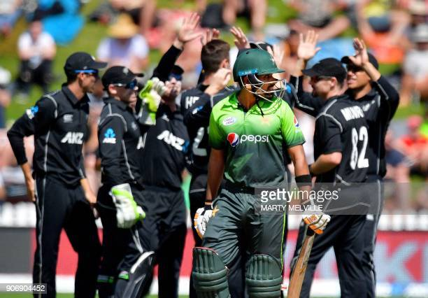 Pakistan's Babar Azam walks from the field after being caught during the 5th oneday international cricket match between New Zealand and Pakistan at...