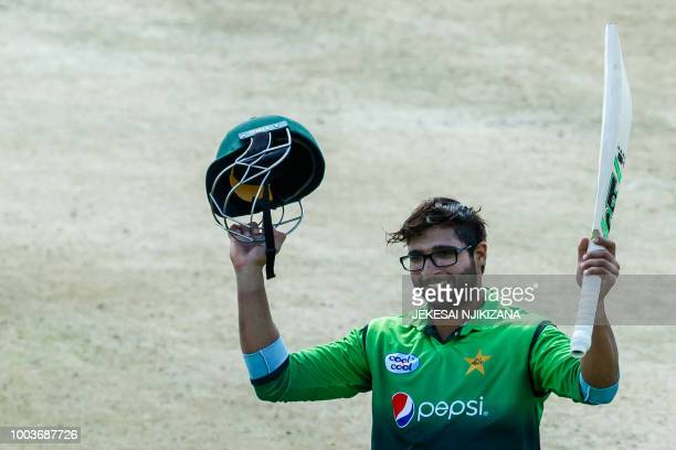 Pakistan's batsman ImamulHaq celebrates his century during the final cricket match of a fivematch ODI series played between Pakistan and host...