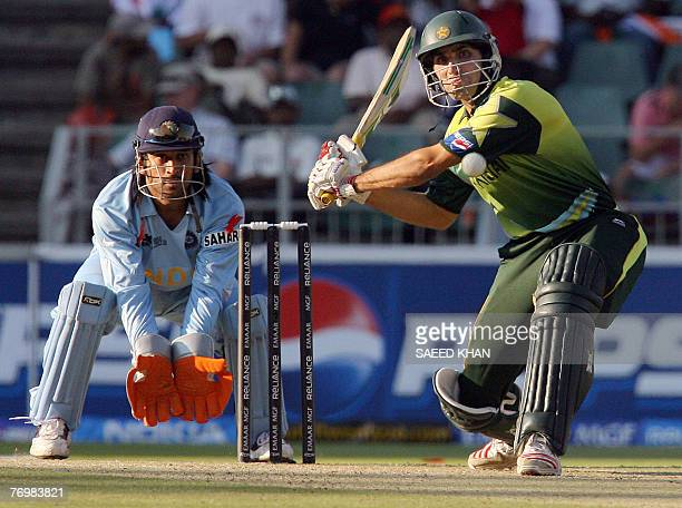 Pakistan's batsman MisbahUlHaq plays for a six as Indian wiketkeeper Mahendra Singh Dhoni watches in the final match of the ICC World Twenty20 at the...