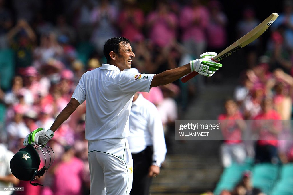Pakistan's batsman Younis Khan celebrates after scoring a century against Australia during the third day of the third cricket Test match at the SCG in Sydney on January 5, 2017. / AFP / William WEST / -- IMAGE