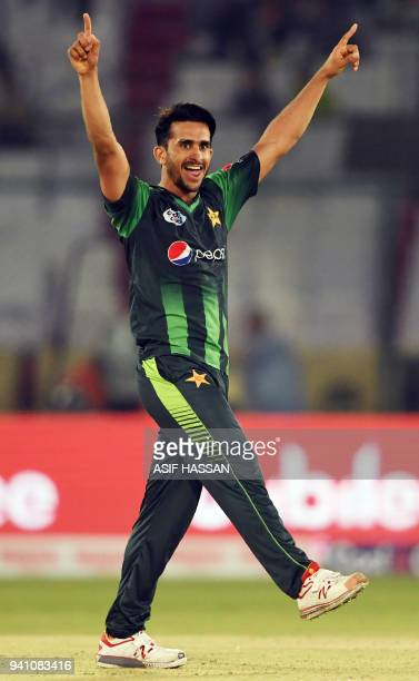 Pakistan's bowler Hasan Ali celebrates after taking the wicket of West Indies' batsman Kesrick Williams during the second Twenty20 International...