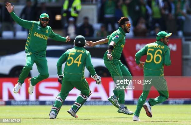 Pakistan's bowler Imad Wasim celebrates the wicket of South Africa's AB de Villiers for 0 runs during the ICC Champions trophy match between Pakistan...