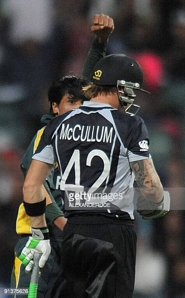 Pakistan's bowler Mohammad Aamir celebrates after his dismissal of New Zealand's cricketer Brendon McCullum for 17 runs during ICC Champions Trophy...