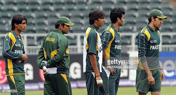 Pakistan's bowler Mohammad Aamir Rana Navedul Hasan Mohammad Asif Rao Iftikhar and Umar Gul wait for their turn during the training session at...