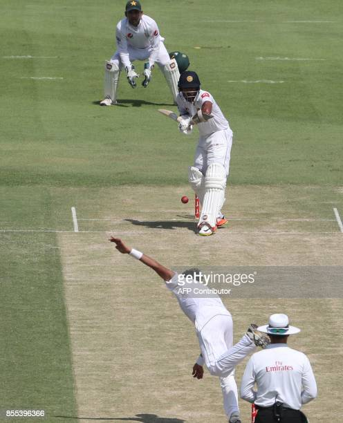 Pakistan's bowler Mohammad Abbas bowls against Sri Lankan batsman Niroshan Dickwella during the second day of their first Test cricket match at...