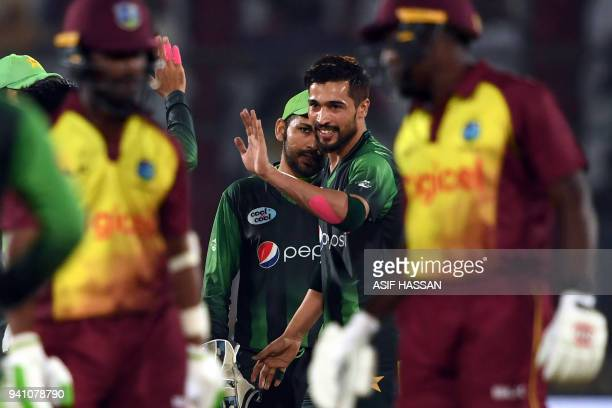 Pakistans' bowler Mohammad Amir celebrates with teammates after the taking the wicket of West Indies' captain Jason Mohammed during the second...