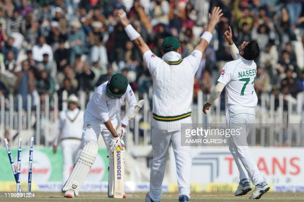 TOPSHOT Pakistan's bowler Naseem Shah celebrates after taking the wicket of Bangladesh's Saif Hassan during the third day of the first cricket Test...